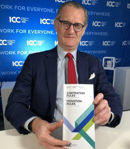 Alexis Mourre sits at a desk with the 2021 Rules of Arbitration for the official launch
